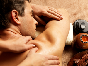 man_having_a_deep_tissue_massage_theupperhanddayspa